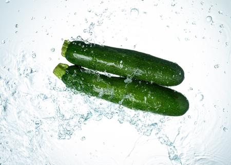 Zucchini Water Splash on white background