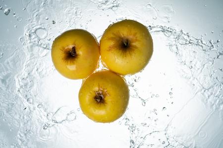 Apples Water Splash on White Background