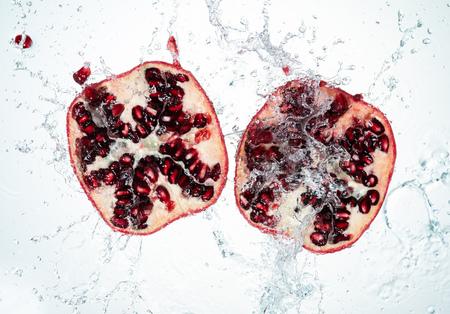 Pomegranate Water Splash on white background Imagens