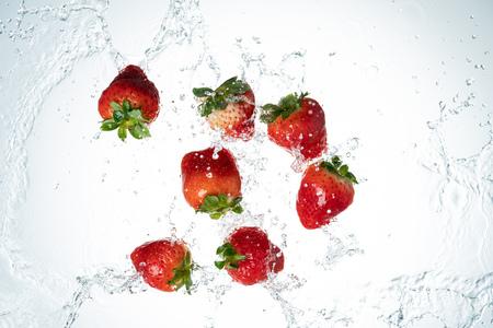 Strawberries Water Splash on white background