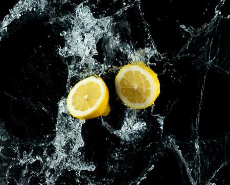 Lemons Water Splash on black background