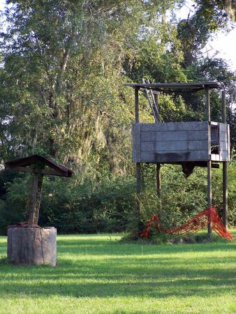 playhouse: old abandoned well and playhouse Stock Photo
