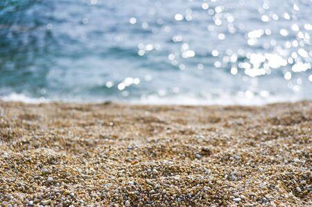 shingle: Shingle on the beach with blue sea Stock Photo
