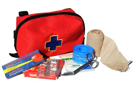 First Aid Kit with content: bandage, painkillers, gauze and scissors