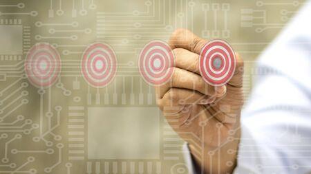 Businessmen choose targets on the system panel. Archivio Fotografico - 150123403