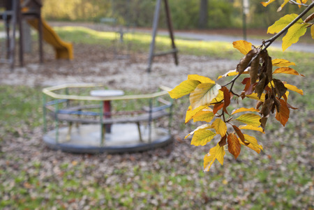 slideshow: A Lost Playground in Autumn with seasonal colors and leaves. Stock Photo