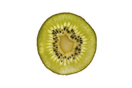 transmitted: A sclice of a kiwifruit over white background with Transmitted Light.