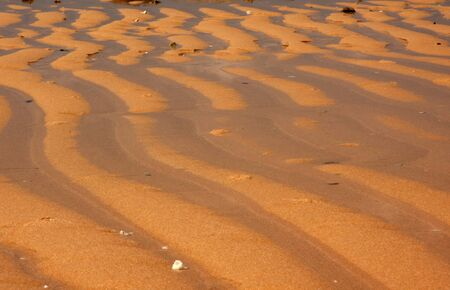 outflow: Malaysia.Tioman island.Summer morning on the beach after outflow the ocean.Patterns on wet sands.
