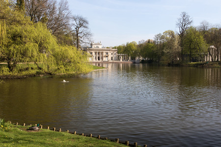 Poland.Warsaw.Lazienki (Bath)Royal Park.view of the palace on the water and a piece of theater on the island, from the center of the park.Photo was taken in April 2015