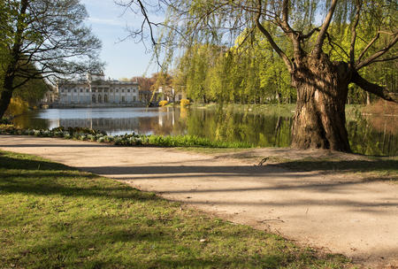 neoclassic: Poland.Lazienki(Bath Royal Park.Horizontal  view of the pond and park background you can see the palace on the water.Photo was taken in april 2015 Editorial