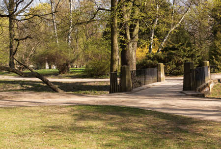 poland.Warsaw.Lazienki (Bath) Royal Park.Horizontal view of the alleys and the historic bridge over Keyway.Photo was taken in April 2015