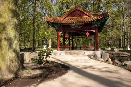 lazienki: Poland.Warsaw.Horizontal view of the Chinese Pavilion in Chinese garden in Lazienki (Bath) Royal park.Photo was taken in April 2015