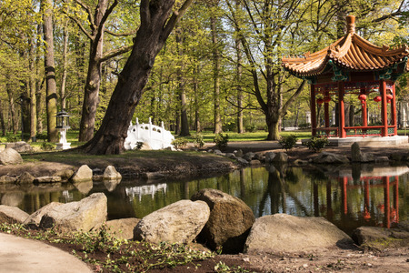 chinoiserie: Poland.Warsaw.Chinese Garden in Lazienki(Bath)Royal Park.Horizontal view of the pond, bridge and pavilion.Photo was taken in April 2015