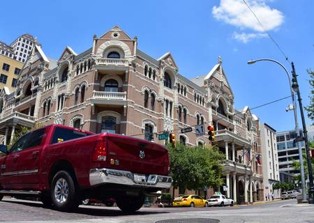 austin: Austin.Texas.United States of America.August 2015Sixth street from the historic tenement house and the side pint vehicle in the street.Editorial Editorial
