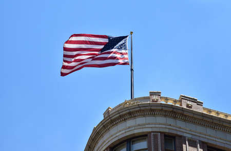 Austin.Texas.United State of America.August 2015.American flag on the Texas State cCpitol building.Editorial.Horizontal view.