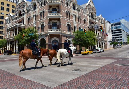 policewomen: Austin.Texas in United States of America - August 2015.Three policemen on horseback patrolling the sixth street.Two policewomen and one policeman.Editorial.Horizontal view.
