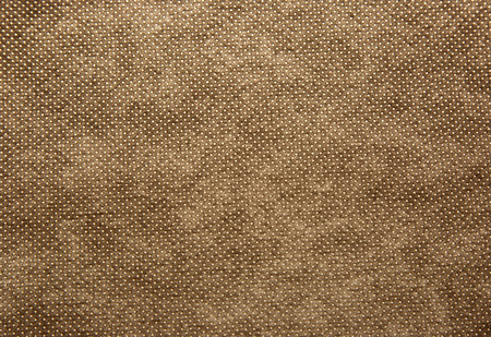 cotton fabric: A sheet of thick, coarsely woven fabric in brown colour.Texture and background.Horizontal view.