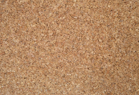 cork sheet: Cork sheet photographed up close. Exactly you can see the structure of cork and a single, irregular elements. Ideal as a background and texture.Brown cork.Horizontal view.