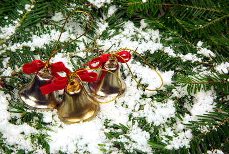 christmas decoration three decorative bells with red ribbons for christmas trees on a background - How To Decorate A Christmas Tree With Ribbon Horizontally