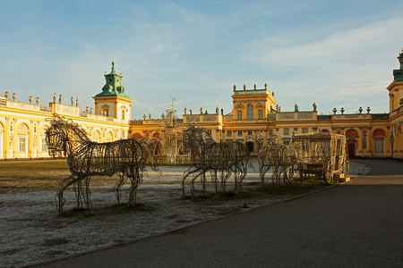 Poland-Warsaw,Wilanow-December 2015.Light decorations in the shape of a carriage with horses in front of the Royal Palace in Wilanow,in Poland,Warsaw 2015.Editorial.