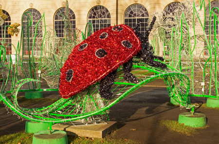 wilanow: Poland-Wilanow,Warsaw in December 2015.Light decorations shaped ladybirds  in the garden conservatory at the Royal Palace of Wilanow, Poland, December 2015