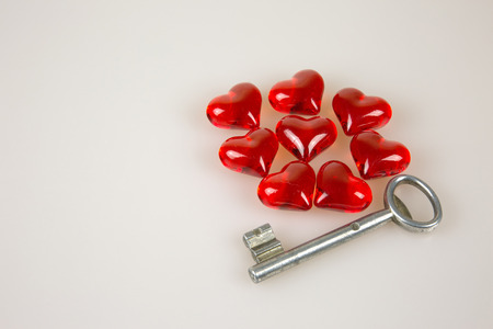 solated on white: Eight,Valentines Day, small red hearts and key ion solated white background.Horizontal view.