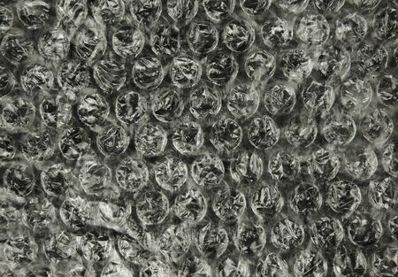 bubble sheet: A sheet of bubble foil with clearly visible bubbles and their structure, interesting background and texture. Close , horizontal view.