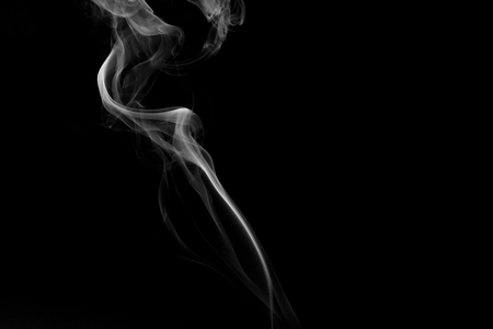 A thick streak of white, grainy smoke on a black background with the effect of the graphic as an abstract background, horizontal view.