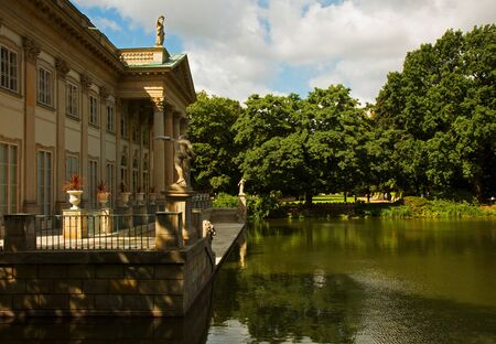 lazienki: View of the pond and the rear part of the Palace on the water (on the island) in summer, Lazienki Royal Park in Warsaw. Editorial. Horizontal view.