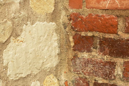 Old wall made of half of stone and red bricks joined by light mortar. Interesting natural background and texture. Horizontal. Reklamní fotografie