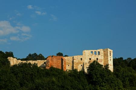 A view of the ruins of a castle among the forest on a background of blue sky, July 2017 in Kazimierz Dolny (Kazimierz on Vistula river).Editorial.Horizontal view. Redakční