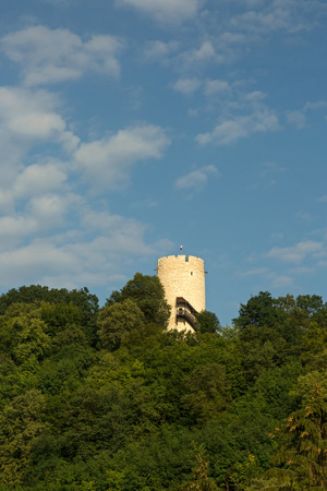 View of a defensive tower built on a hill in the fourteenth century against the blue sky in Kazimierz Dolny (Kazimierz on the Vistula) , July 2017 Editorial. Vertical view.