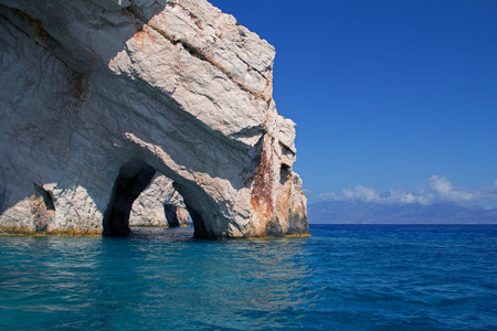 Beautiful blue waters of the bay and sea view at Blue Caves on Zakhyntos Island in Greece. September. Horizontal view