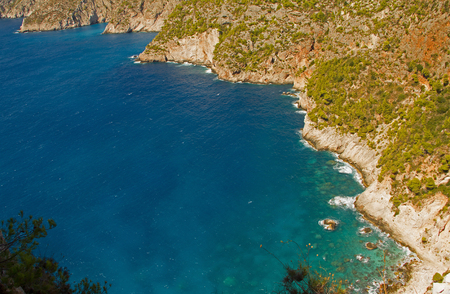 A beautiful landscape with a view from above on a blue bay and a fragment of the rocky island of Zakhyntos in Greece. Top, horizontal view