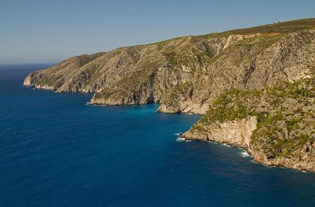 Beautiful landscape overlooking the rocky coast and the blue ocean around Zakynthos Island under blue sky.Horizontal view. Reklamní fotografie