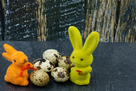 Easter decoration, two bunnies and eggs on a rustic vintage background.Horizontal view. Reklamní fotografie