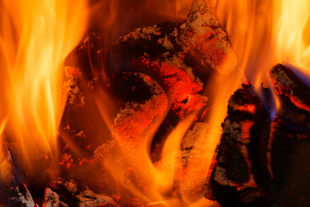 Closeup of flames and red heat, interesting abstract background and texture.Horizontal view