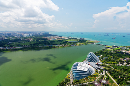 Singapore - April 2018.View from the top floor Marina Sands Hotel at Gardens by the bay and Marina bay in Singapore, April 2018.Editorial.Horizontal view.