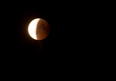 Half of the eclipse of the moon, phase IV eclipse of Poland in July 2018.Horizontal view with copy space on the right side Stok Fotoğraf