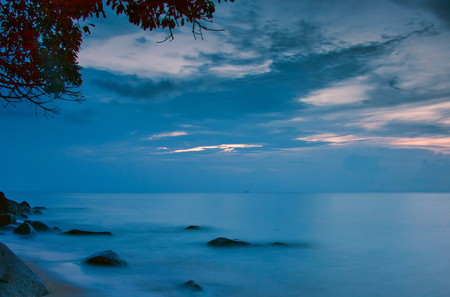 Malaysia, Tioman island. Early evening above the island and the ocean, the blue light of a calm evening. Beautiful, calm seascape