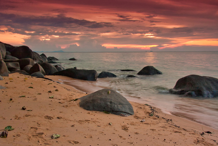 Malaysia, Tioman island. Sunset with a strong red light of the early evening and beautifully highlighted clouds. An interesting, beautiful landscape Stok Fotoğraf