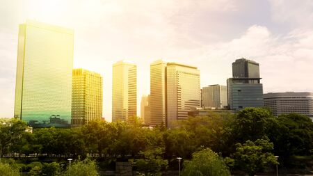 Skyscrapers in Osaka Japan during the sunset - business finance concept
