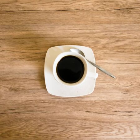 Cup of black coffee on the wooden background Reklamní fotografie - 150122972