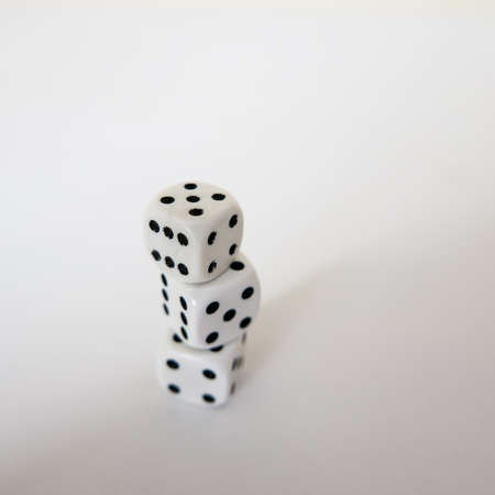 White dices on the white background
