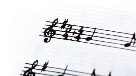 Key, double time signature symbol and violin clef. Musical notation macro, closeup. Single line sheet music detail example, playing an instrument, learning theory abstract concept, music background