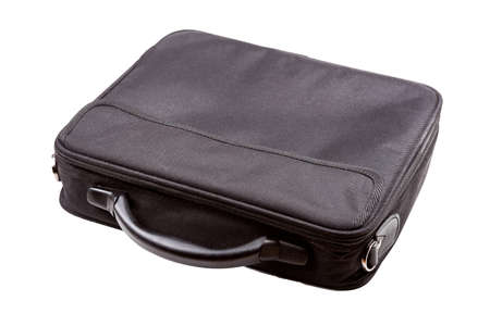Simple black laptop bag isolated on white. Pocket notebook container laying on the table top view angle. An elegant pc bag with a handle without a strap. Protection case for business personal laptop