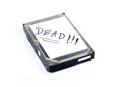 Dead defective silver metal 3.5 inch thick hard drive storage with a white text label isolated on white, object. Personal data loss and recovery from old broken damaged defective disk abstract concept
