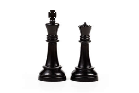 King and queen, two simple chess figures isolated on white, cut out. Royal couple, royalty abstract concept, pair of game pieces, chess symbol, power and leadership, leading Foto de archivo