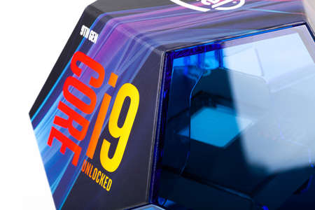 Cracow, Malopolska / Poland - October 12 2019: Intel Core i9 9900k CPU, modern 5ghz Coffee Lake processor in a original blue box side view, macro, closeup. Product shot isolated on white, die visible