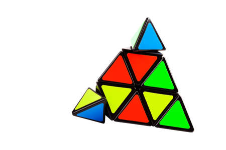 Triangular pyramid toy, complex logical puzzle with moving elements, parts isolated on white. Brain teaser, problem solving, intelligence, intellect, simple solutions, simplicity abstract concept